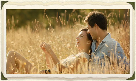 Picture frame of happy couple in a golden field.